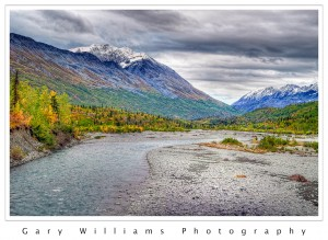 Photograph of a snow covered mountain and river near Valdez, Alaska