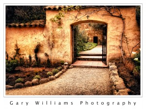 Photograph of a gate and path at the Carmel Mission near Carmel, California