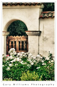 Photograph of the gate to the cemetery at the Mission San Juan Bautista, California