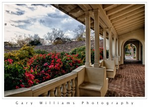 Photograph of flowers framed by arches at City Hall, Monterey, California