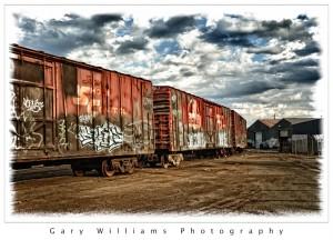 Photograph of railroad boxcars and graffiti in Fresno, California