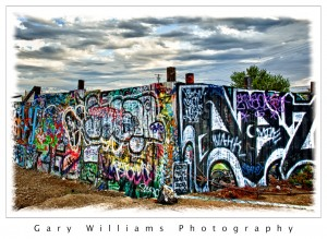 Photograph of graffiti on a fence in Fresno, California