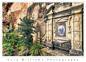 Photograph of a statue and flowers at Carmel Mission, Carmel, California