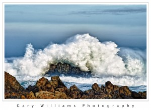 Photograp Photograph of a wave crashing against rocks at Asilomar Beach, Pacific Grove, California