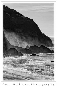Photograph of waves and rock formations along the coast near Bandon, Oregon