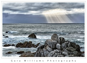 Photograph of light rays over the ocean at Pacific Grove, California