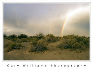 Photograph of a rainbow in Death Valley, California