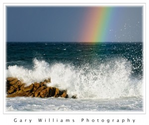 Photograph of a rainbow over the ocean at Pacific Grove, California