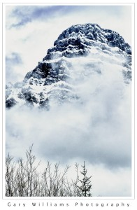 Photograph of a cloud covered peak from the Icefields Parkway, Canada