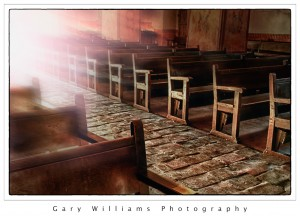 Photograph of the sun shining down the aisle of the San Juan Bautista Mission on the winter solstice