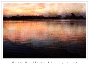 Photograph of sunrise at Moss Landing harbor blended with a background texture applied