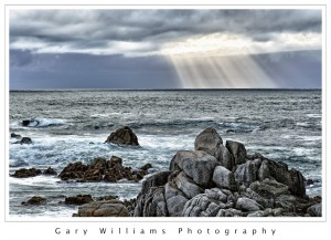 Photograph of a crepuscular light ray over the Pacific Ocean at Asilomar beach, California