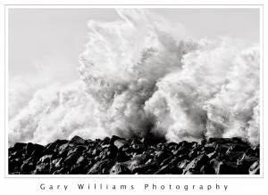 Black and White Photograph of a large wave at Morro Bay, California