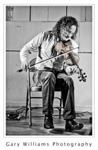 Photograph of Irish Fiddler Martin Hayes playing the violin