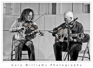 Photograph of Irish Fiddler Martin Hayes playing the violin and Dennis Cahill playing the guitar