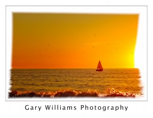 Photograph of a sailboat at sunset off the central California coast near Moss Landing, California