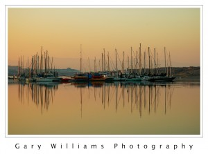 Photograph of boats at Moss Landing Yacht Harbor at sunrise