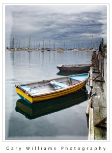 Photograph of a row boat at Monterey Harbor