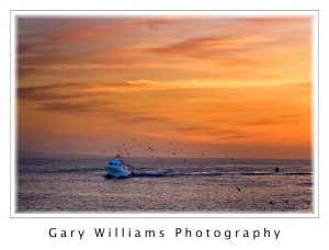 Photograph of a fishing vessel at sunset off the central California coast near Moss Landing, California
