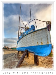 Photograph of a boat on dry land at Moss Landing, California