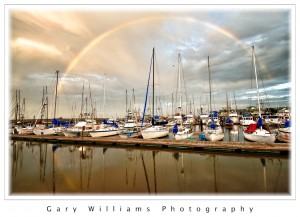 Photograph of boats and a rainbow at Moss Landing Harbor