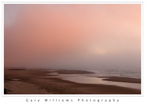 Photograph of a beach at sunset along the Oregon coast