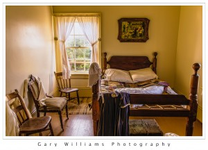 Photograph of the bedroom of the Yaquina Bay Lighthouse along the southern Oregon coast at the Yaquina River near Newport, Oregon