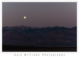 Photograph of a full moon setting over Telescope Peak, Death Valley National Park