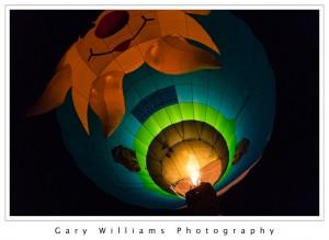 Photograph of a Hot Air Balloon ascending before dawn at the Albuequerque Balloon Fiesta