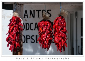 Photograph of red chile ristras near Chimayo, New Mexico