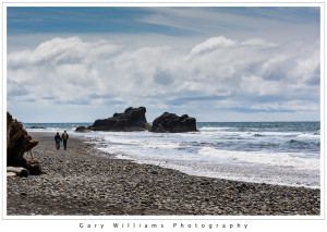 Photograph of a couple walking along Ruby Beach along the Washington coast near the Olympic National Park