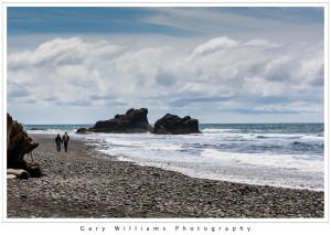Photograph of a couple walking along Ruby Beach along the Washington coast near the Olympic National Park