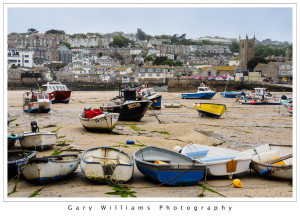 Photograph of boats at ebb tide in St. Ives Harbor, Cornwall, England