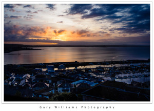 Photograph of boats and harbor at sunrise from Newlyn, Cornwall, England