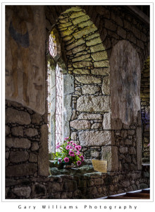 Photograph of a stone window of the church in St. Just, Cornwall, England