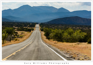 Photograph of New Mexico State Road 14 looking back toward the Sandia Mountains.