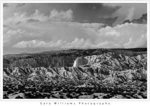 Black and white photograph of mountain ridges and clouds near Chimayo, New Mexico