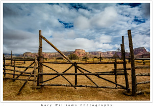 Photograph of an old fence and redrock cliffs at Ghost Ranch near Albiquí, New Mexico