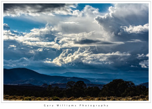 Photograph of clouds and mountains in northern New Mexico