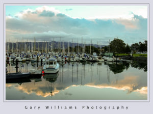 Photograph of boats in a harbor at sunrise in Berkeley, California