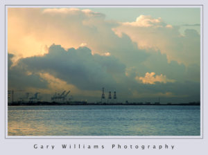 Photograph of clouds, and the Oakland waterfront looking from Berkeley, California