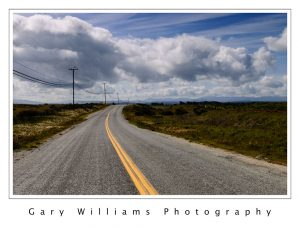 Photograph of a farm road and clouds near Marina, California