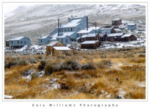 Photograph of mining buildings in the snow at the ghost town of Bodie, California