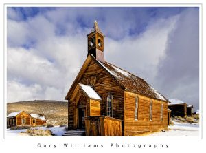 Photograph of the Methodist Church in the snow at the ghost town of Bodie, California