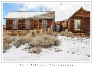 Photograph of abandoned houses in the snow at the ghost town of Bodie, California