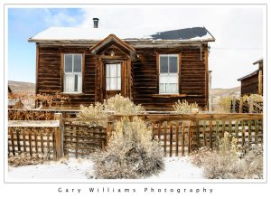 Photograph of an abandoned house in the snow at the ghost town of Bodie, California