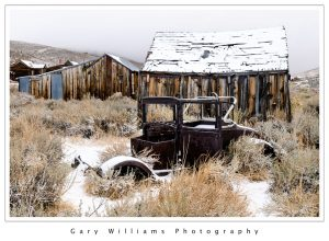Photograph of an abandoned car in the snow at the ghost town of Bodie, California