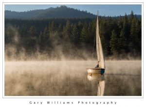 Photograph of a sailboat on a quiet lake in Kings Canyon National Park, California