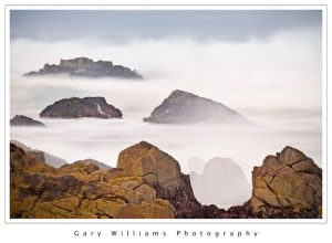 Photograph of rocks in mist at Asilomar, Pacific Grove, California