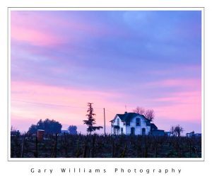 Photograph of an old farm house at sunrise in Easton, California
